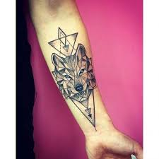 blue eyed geometric wolf on triangles forearm tatuajes
