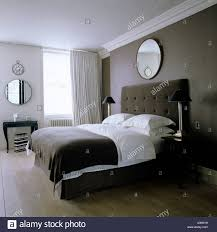 modern bedroom with round mirrors designed by john minshaw stock modern bedroom with round mirrors designed by john minshaw