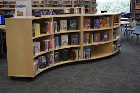 roll it over mobile shelving helps libraries to open up space