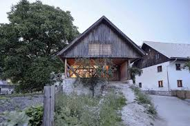 an old cattle barn in slovenia is saved and transformed into a