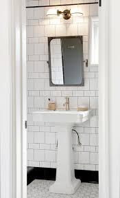Bathroom Mirror Vintage White Pedestal Sink With Aged Brass Rivet Mirror Transitional
