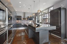 stainless steel island for kitchen ultra modern kitchen with stainless steel island stock photo
