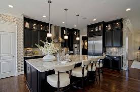 big island kitchen black kitchen cabinetry with marble countertop and