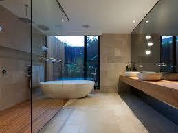 bathroom medium tone wood cabinets freestanding tub wall mount