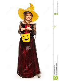 wearing halloween witch costume with bucket stock photo