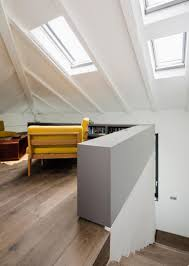 1920s vertical loft with modern and airy interiors digsdigs even the attic space was smartly used and decorated with mid century modern furniture