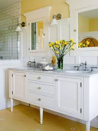 bathroom white painted paneling covers three fourths of the