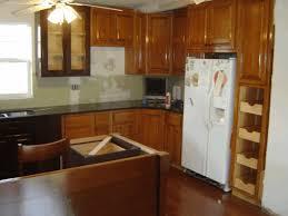 kitchen cabinet corner storage plain black floor tile white wooden