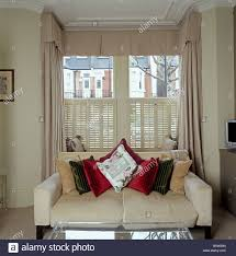 Beige Linen Curtains Cream Sofa Piled With Cushions In Front Of Window With Beige Linen