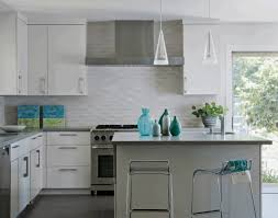 backsplash edge of cabinet or countertop neutral glass tile backsplash dark cabinets dark floors medicine