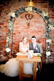 wedding flower arches uk packington moor wedding flowers country jugs tree slices