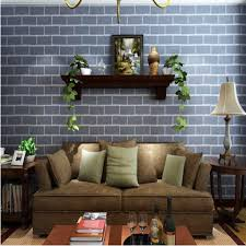 grey best brick wall tiles with brown couch and floating shelves