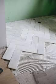 bathroom tile floor designs bathroom flooring light tile in herringbone pattern remodel