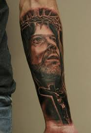 black ink jesus on right forearm