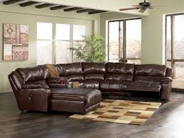sleek leather sectional with chaise and recliner in chocolate