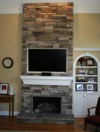 corner stone fireplace escorted by river rock walling cool gypsum corner stone fireplace escorted by river rock walling cool gypsum wall tv shelves in white colour intimating woden cabinet escorted by book shleves corner
