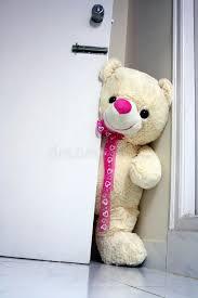 big teddy big teddy opening the door stock photo image of friendship