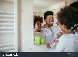 Mirror In The Bathroom by Portrait Black Dad Daughter Brushing Teeth Stock Photo 610113026