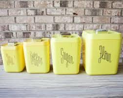 plastic kitchen canisters sale mid century 1950s yellow plastic bakelite typographic