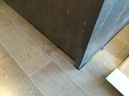 can i put cabinets on vinyl plank flooring kitchen cabinets were installed before the floor