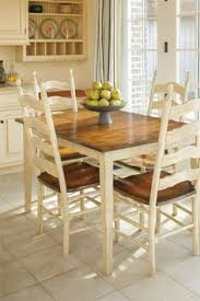 bramble round dining table and six ladder back chairs trovato