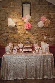 wedding backdrop linen pink and gold candy buffet on sequin linen with pom pom and pearl