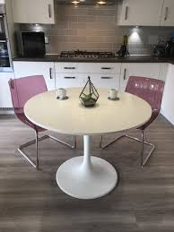 ikea docksta white dining table with 2 ikea tobias purple chairs