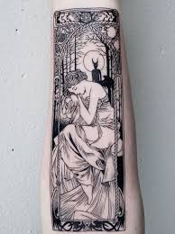 fine line tattoo artist creates detailed black ink tattoo art
