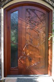 hand carved door olive tree carved in wood and theme continued in