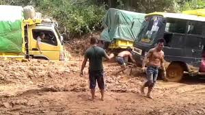 muddy truck recovery truck fuso by bus and truck in muddy road youtube