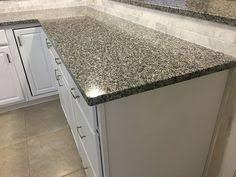 Chiaro Tile Backsplash by Sienna Bordeaux Granite Counters And Subway Tile Backsplash