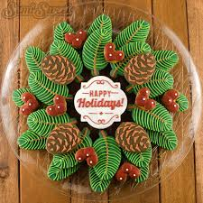 pine wreath and berries decorated christmas cookie platter the