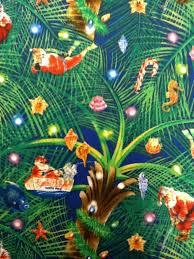 christmas xmas santa at the beach palm trees blue background