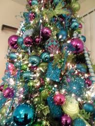 blue and silver ornaments on an artificial wreath turquoise blue
