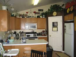 ideas for tops of kitchen cabinets top of kitchen cabinet decor ideas mariannemitchell me
