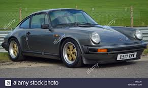 porsche metallic metallic grey porsche 911 with gold fuchs wheels stock photo