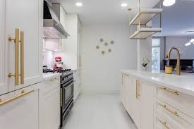 kitchen cabinets with gold hardware a kitchen with white shaker cabinets and gold brass
