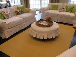 living room amazing sofa with white surefit cover on wooden