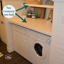 collection in folding table over washer and dryer with laundry