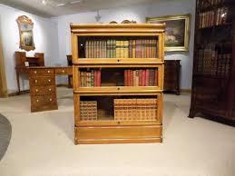 an oak edwardian three stacking bookcase by globe wernicke 1900