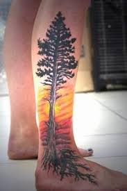 yellow and tree on leg tattoomagz