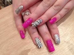 gel nails with pinky purple gel polish and zebra print nail art