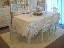 interior white fabric ruffled tablecloth for round table