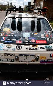 toyota white car rear view of a small toyota white car with numerous badges and