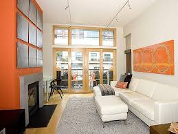 orange accent wall for modern narrow living room ideas with