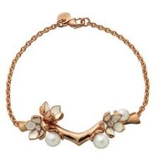 enamel gold bracelet with pearls and key designs for