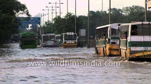 vehicles wade the water logged roads following heavy rains in