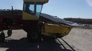 new holland 1100 self propelled windrower with conditioner youtube