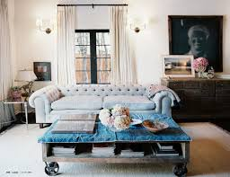 a romantic tufted grey sofa with rustic and industrial furniture