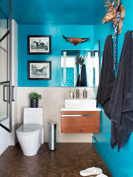 10 paint color ideas for small bathrooms diy network blog made modern small bathroom with bold teal walls floating vanity and animal wall decor